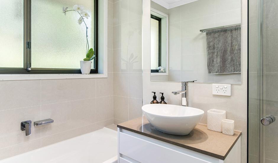 Cook – Bathroom 2 – Stone benchtop and sleek tapware_940