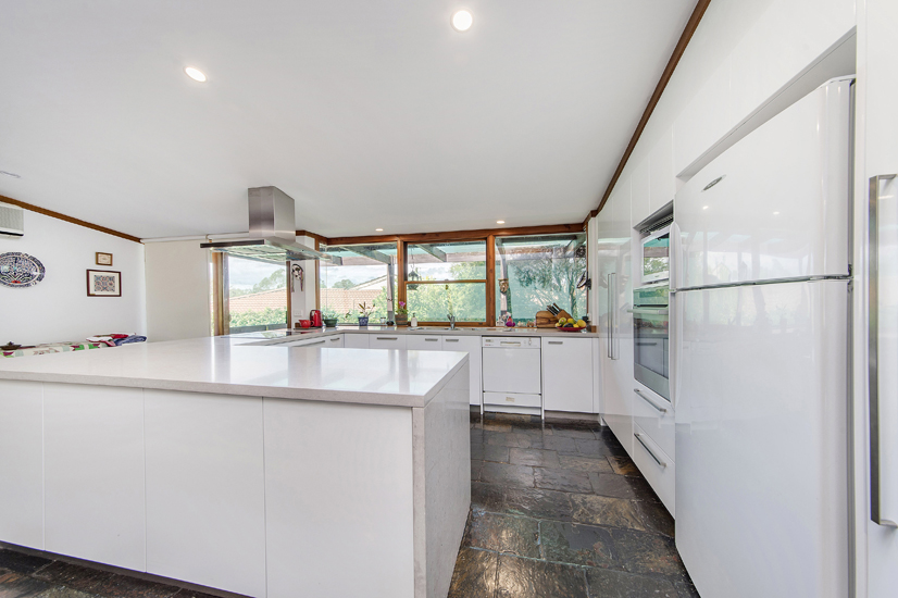 Kitchen 2 – Accessible cupboards from both sides of the island bench